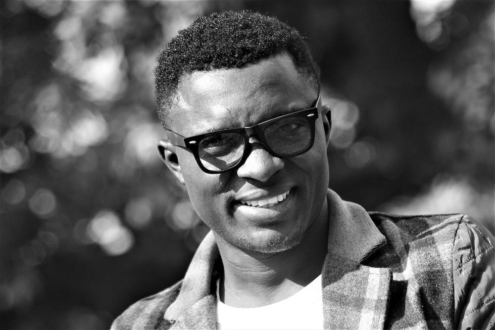 man wearing black frame eyeglasses