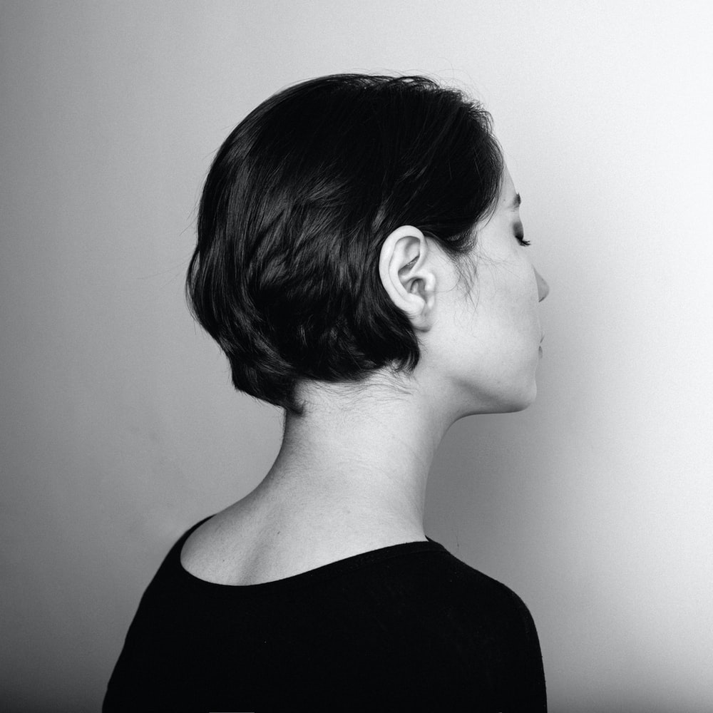 grayscale photography of woman facing her right side