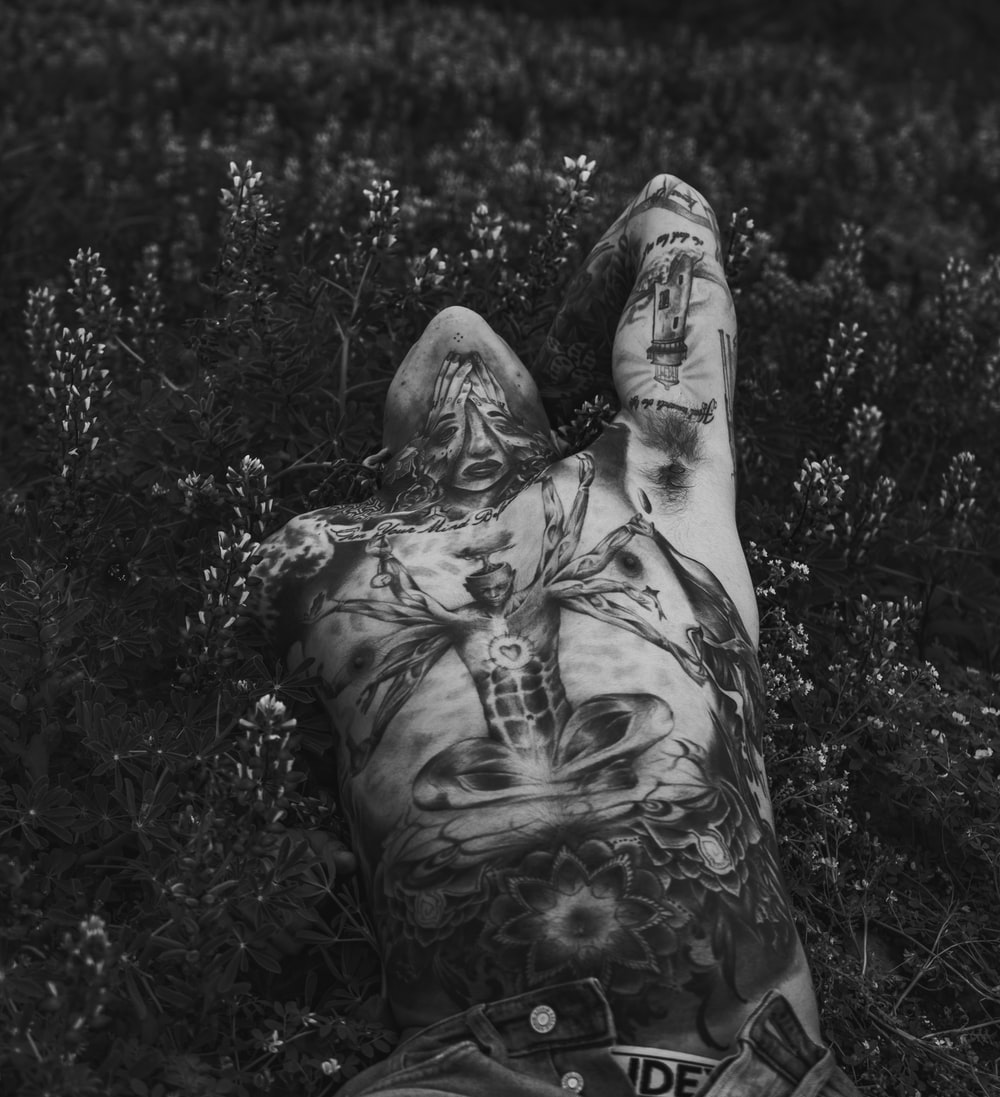 man lying on plants