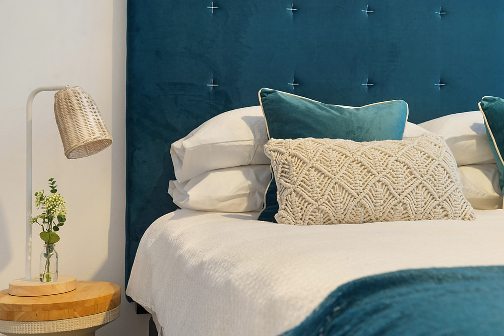 blue bed and mattress with pillows