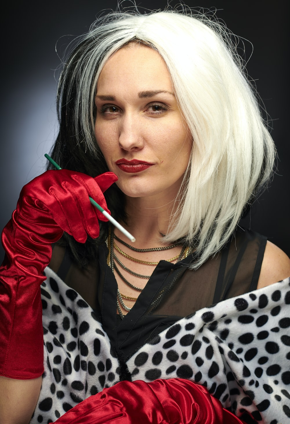 woman wearing Cruella de Vil costume