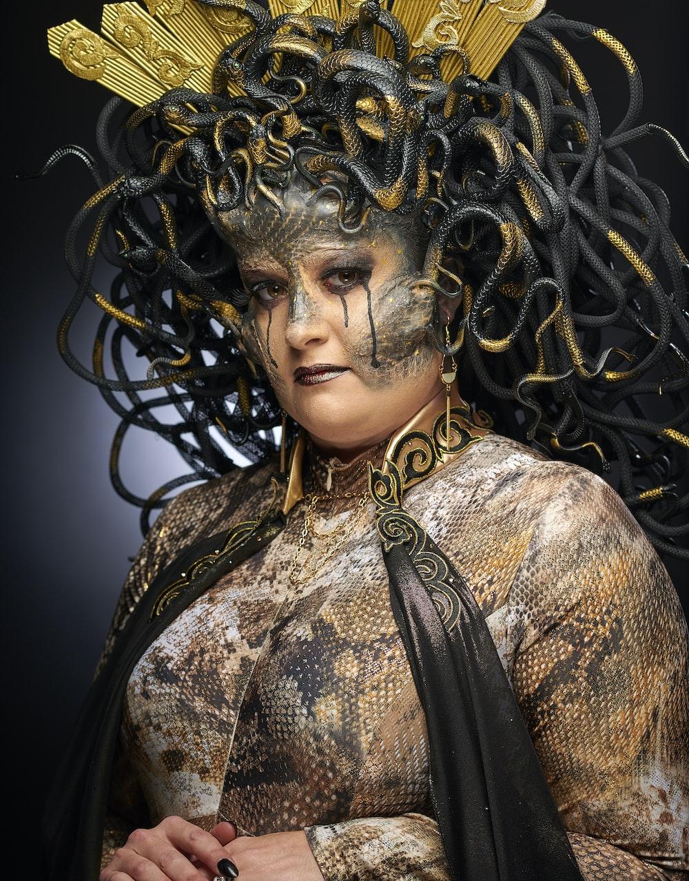 woman wearing black and grey Medusa costume