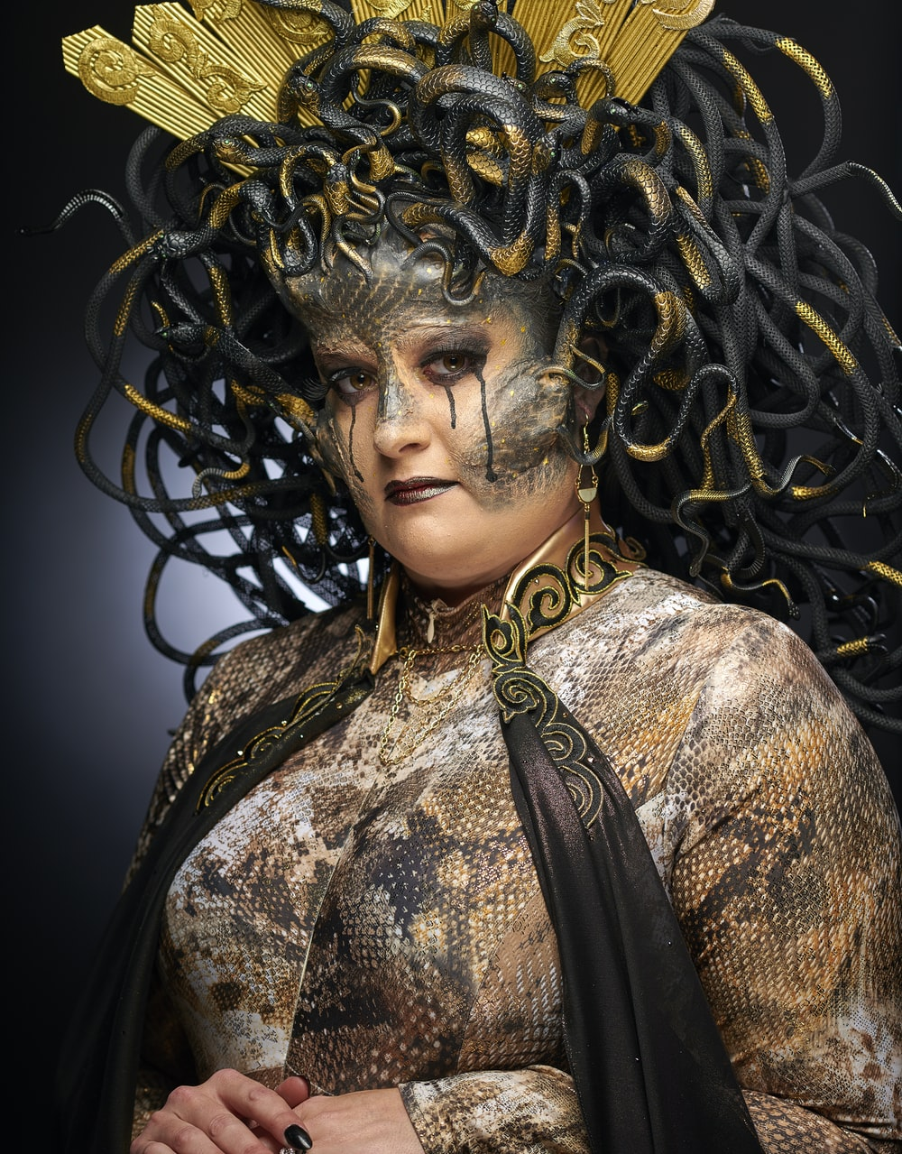 woman wearing black and grey Medusa costume