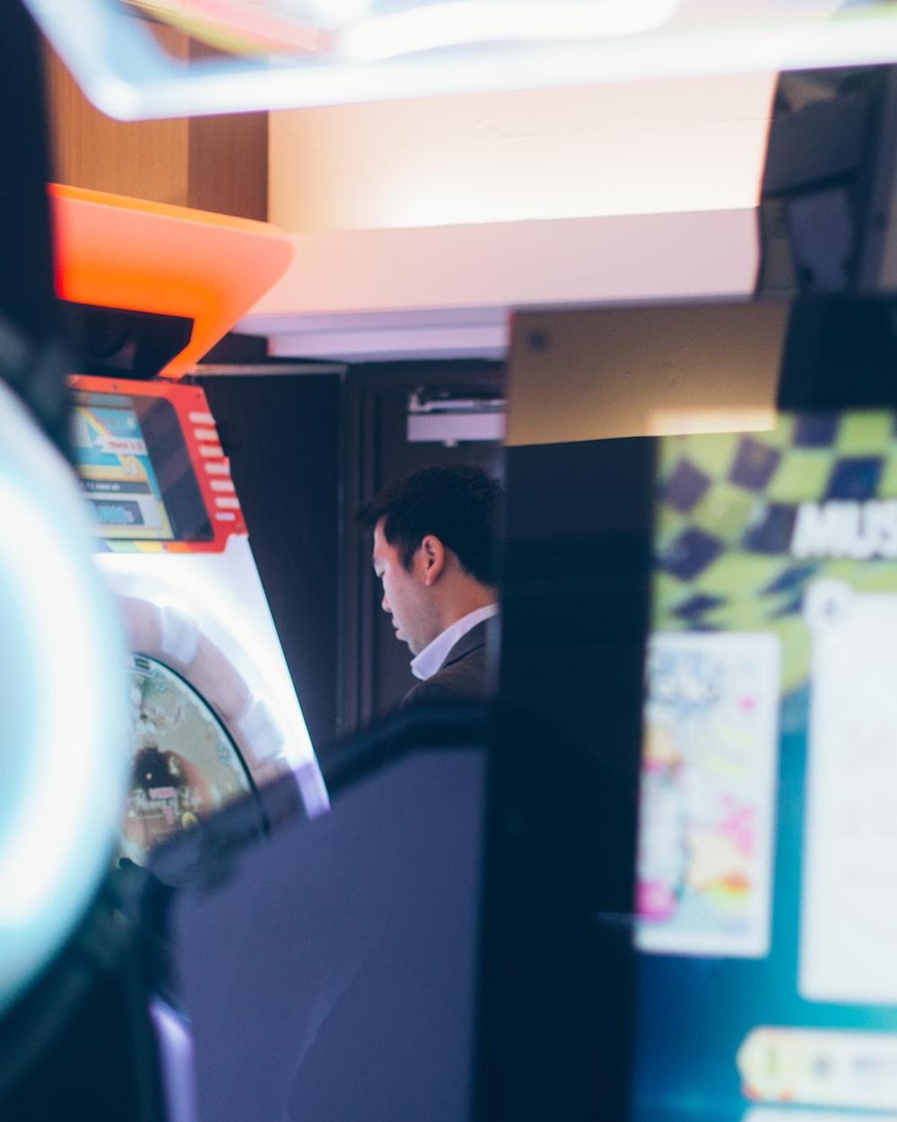 man facing game arcade machine