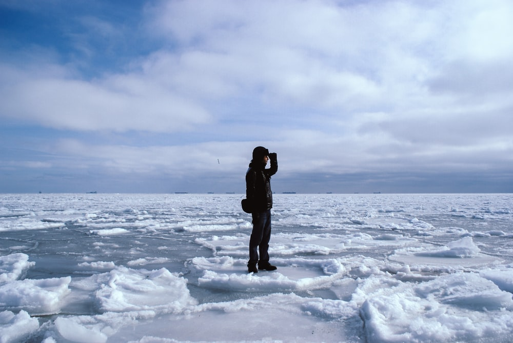 man standing on snowfield during day