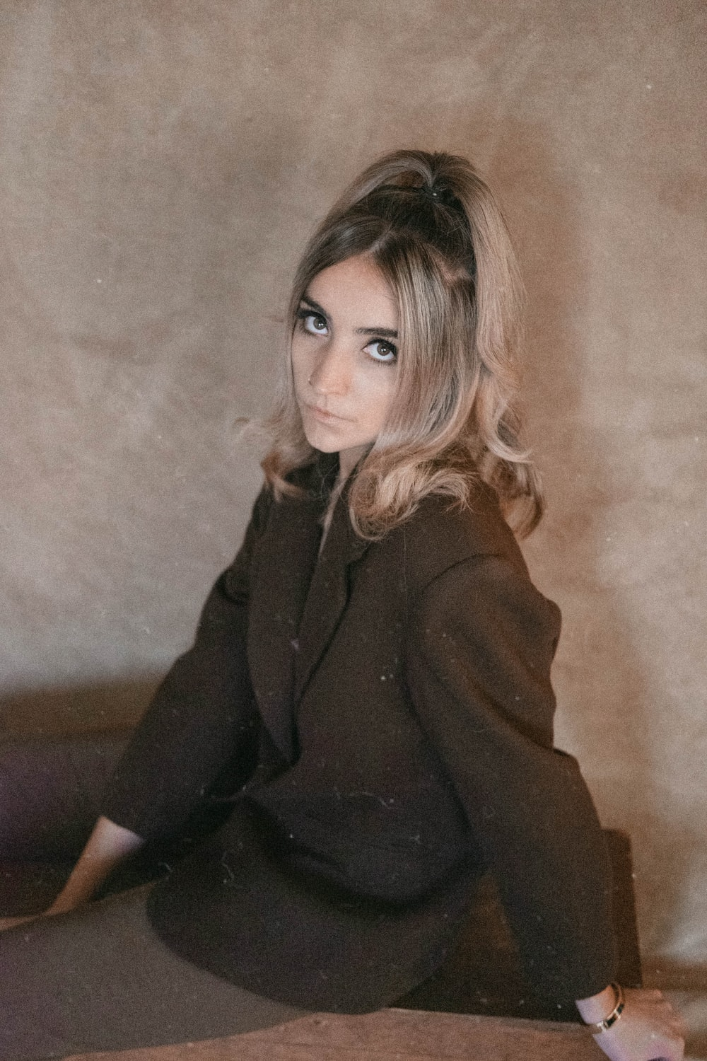 shallow focus photo of woman in black coat