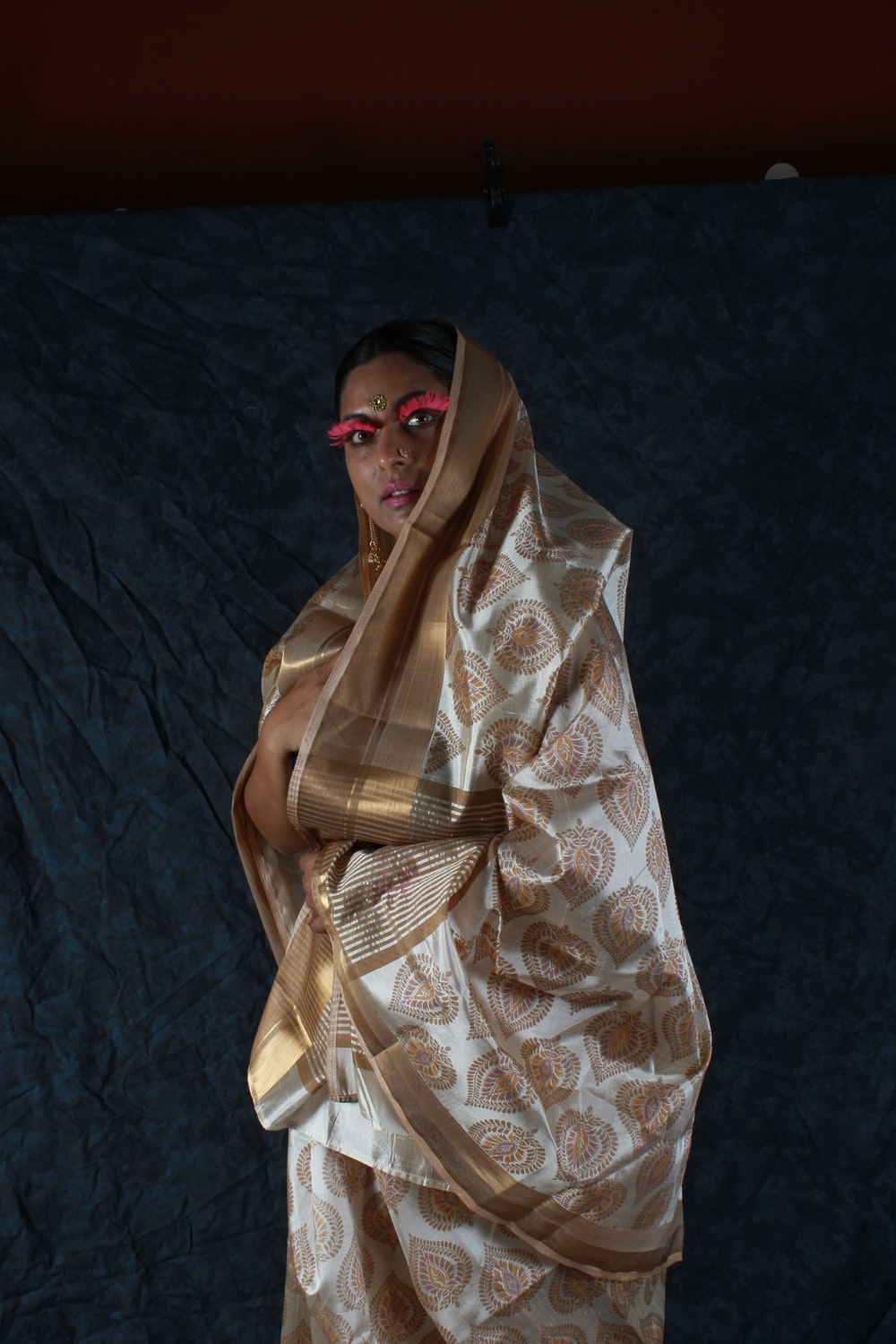woman covered by brown and gray sari drape