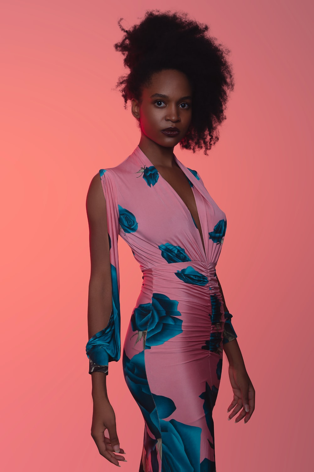 woman wearing pink and blue floral dress