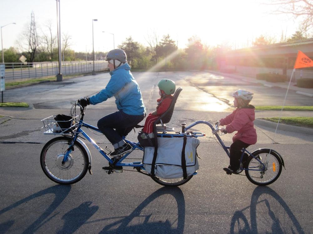 2 men riding on bicycle during daytime