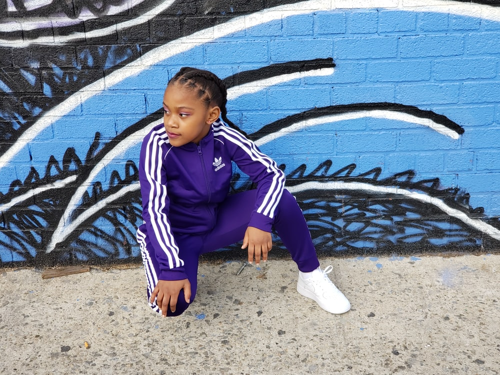 woman wearing purple and white adidas tracksuit
