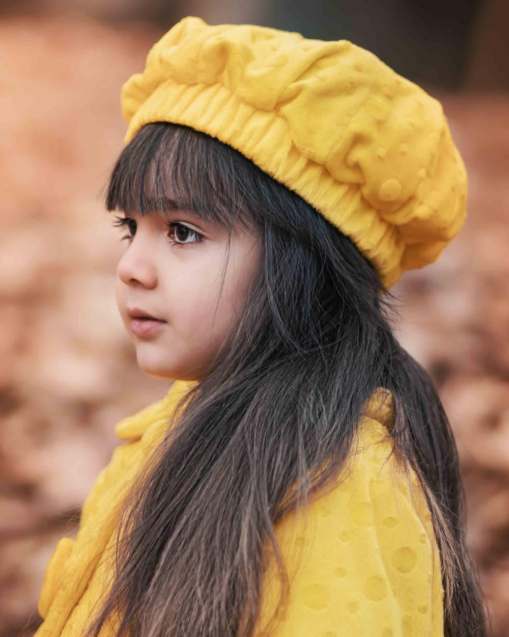 girl wearing yellow hat and yellow dress