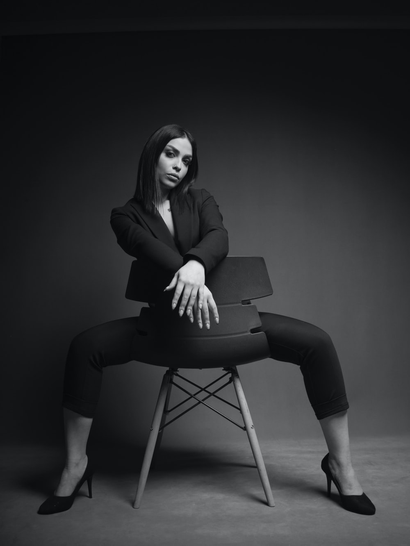 woman wearing black suit