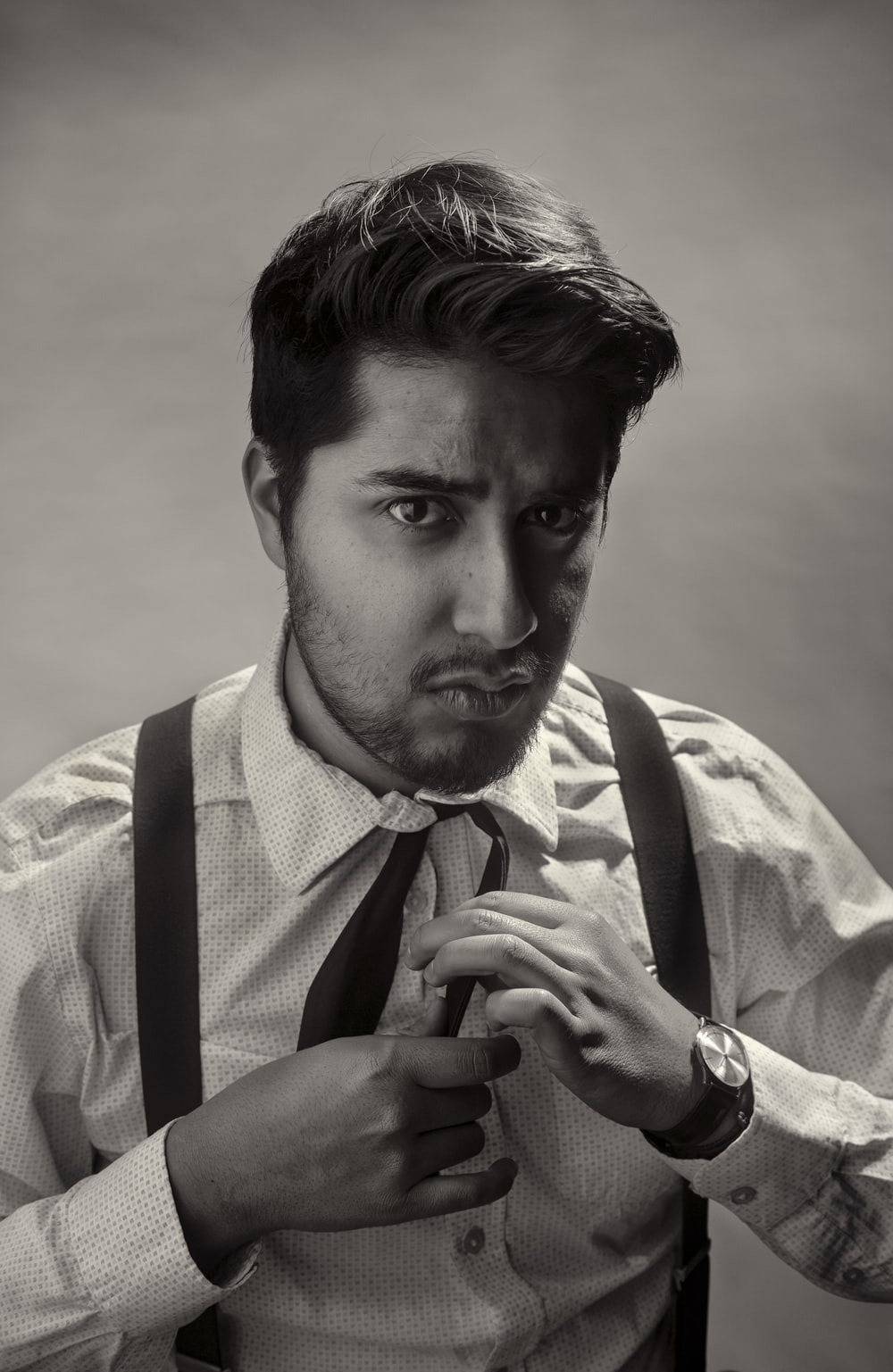 grayscale photo of man in dress shirt