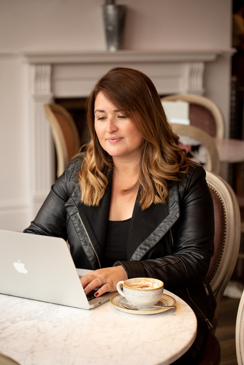 selective focus photography of woman using MacBook
