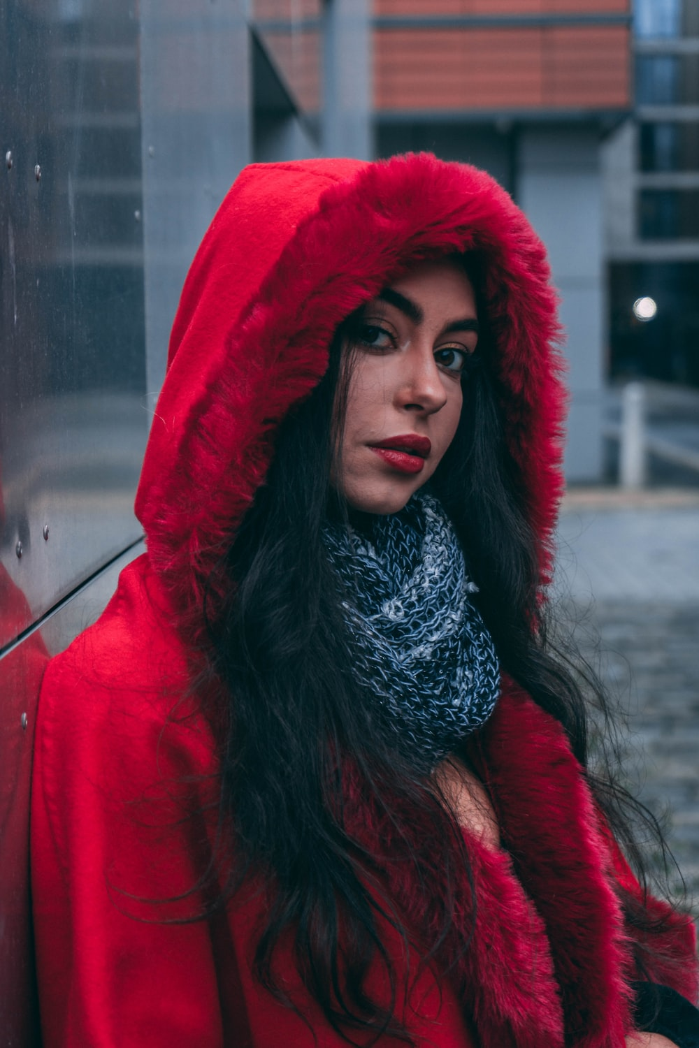 selective focus photography of woman wearing red hoodie