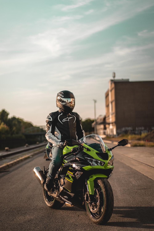 man riding on the green sports bike
