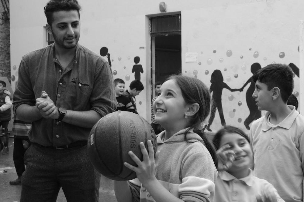 girl holding the ball