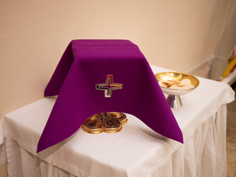 purple holy communion on table