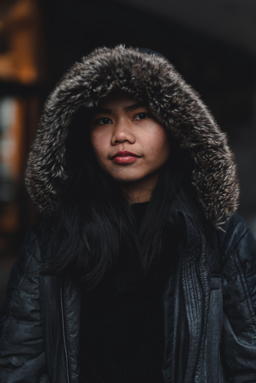 selective focus photography of woman wearing black hoodie