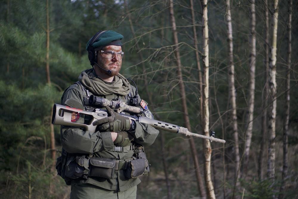 soldier man holding assault rifle standing