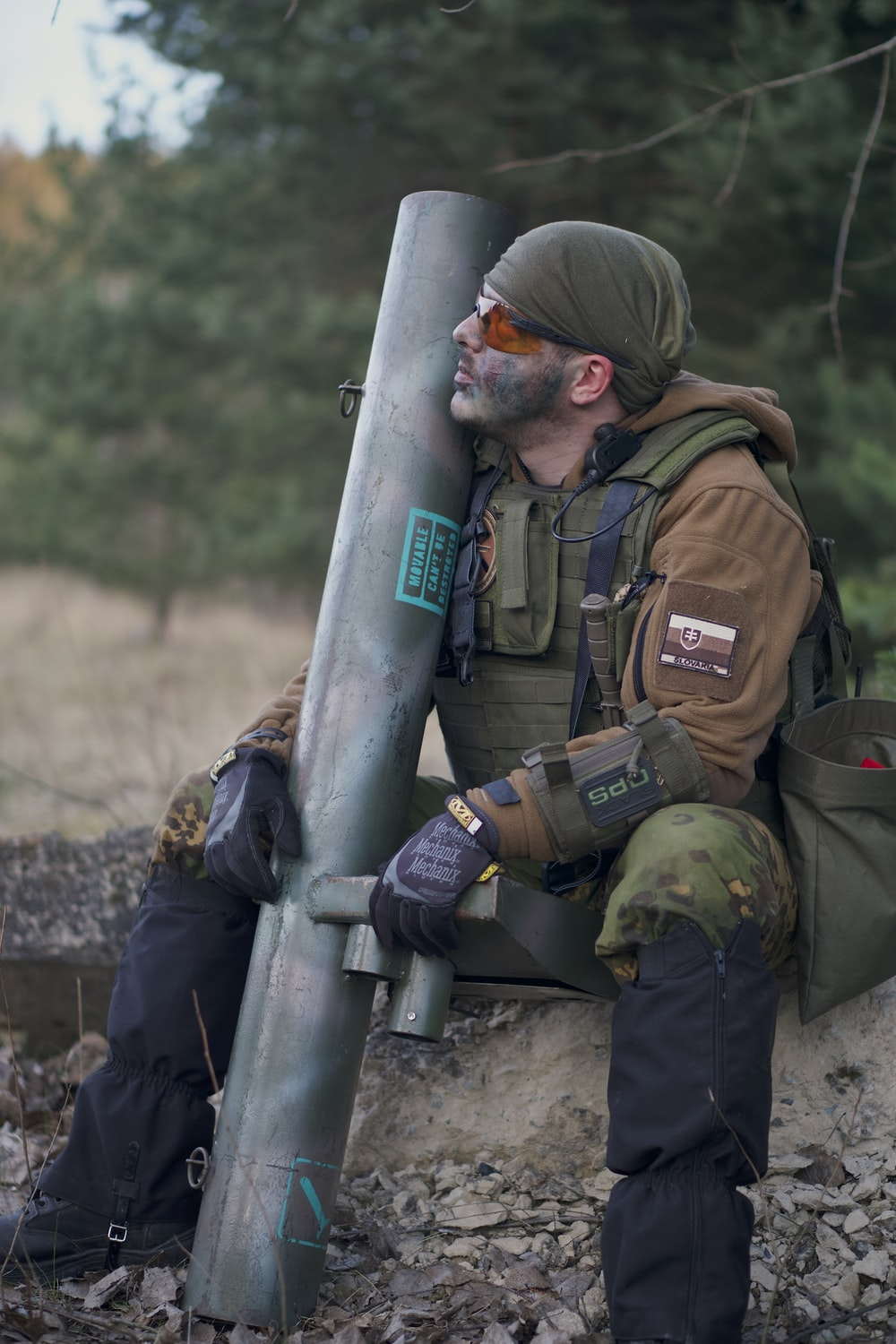 soldier man wearing tactical vest sitting while looking up