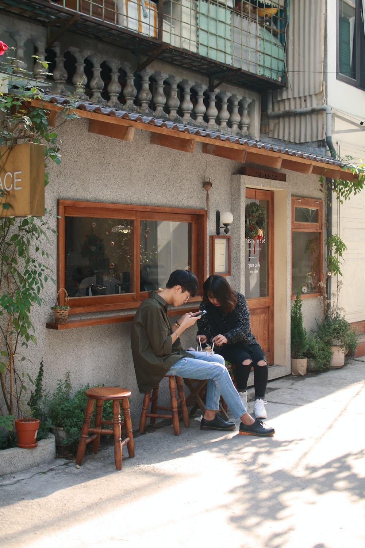 couple sitting on stool outside