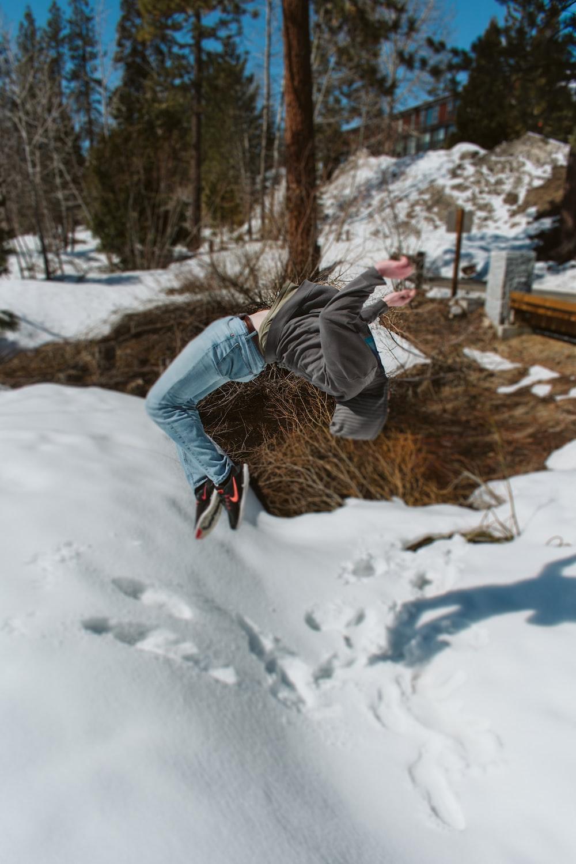 person doing backflip on snow