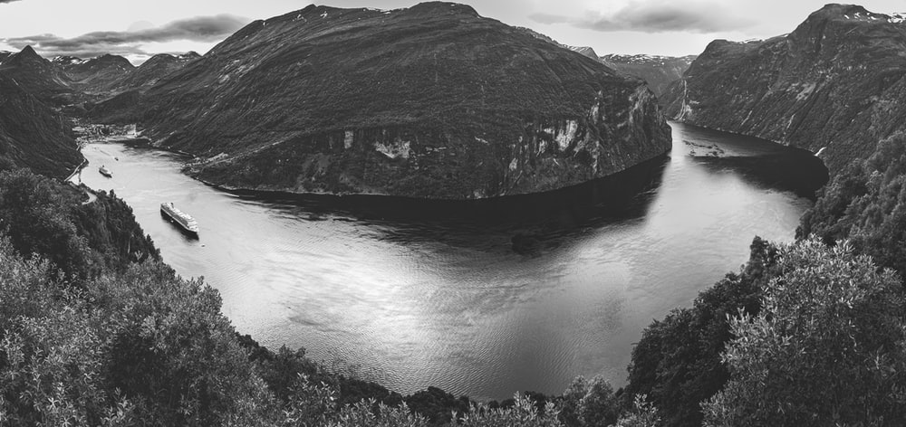grayscale photo of mountain and river
