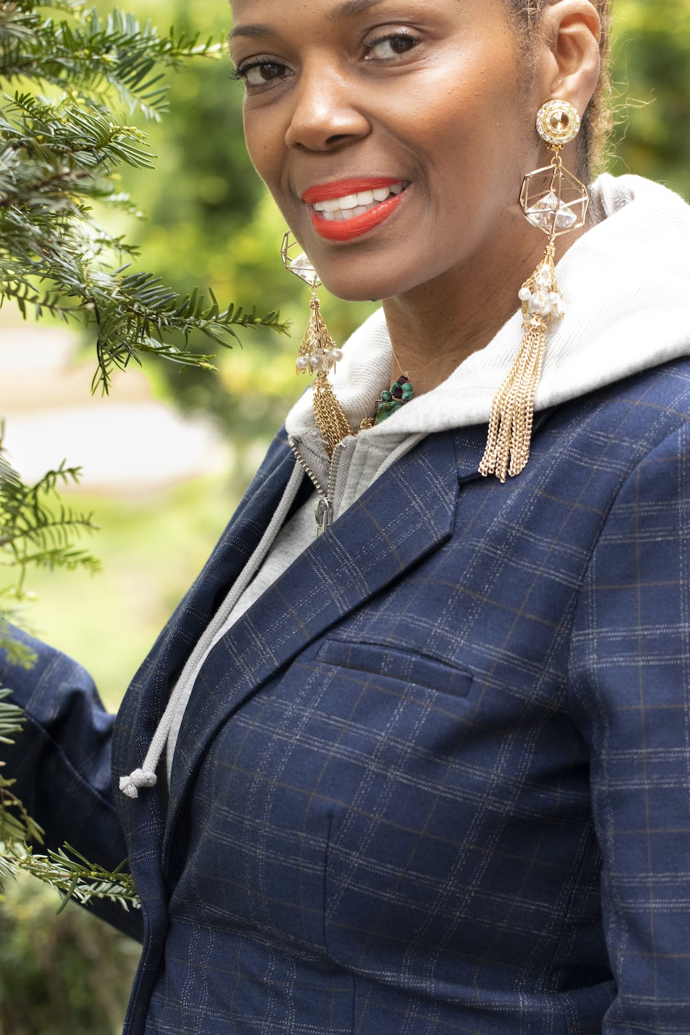 woman in blue and white plaid blazer