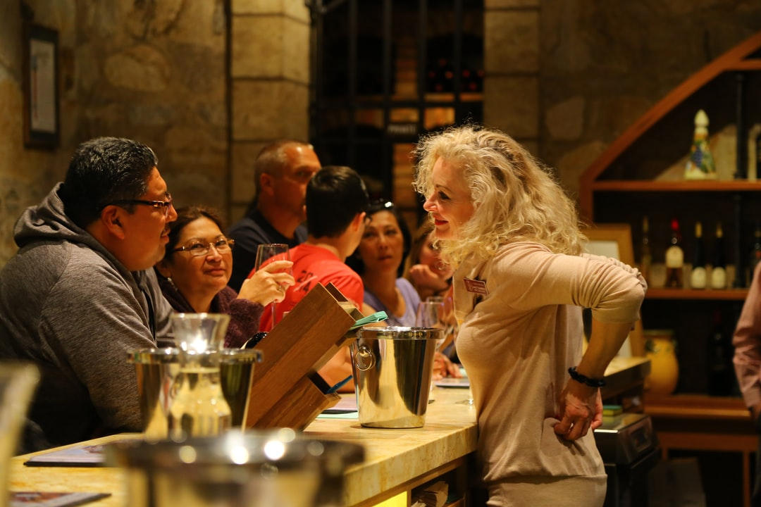 People tasting wine in Napa Valley Wine Caves.  Please add a backlink to https://tarta.ai if when using the photo.