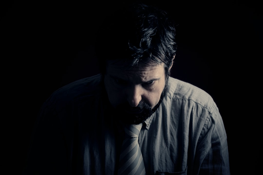 A Sad Depressed Man Sitting In the Darkness. Bad Feelings, Human Emotions, the Face of Depression. - unsplash