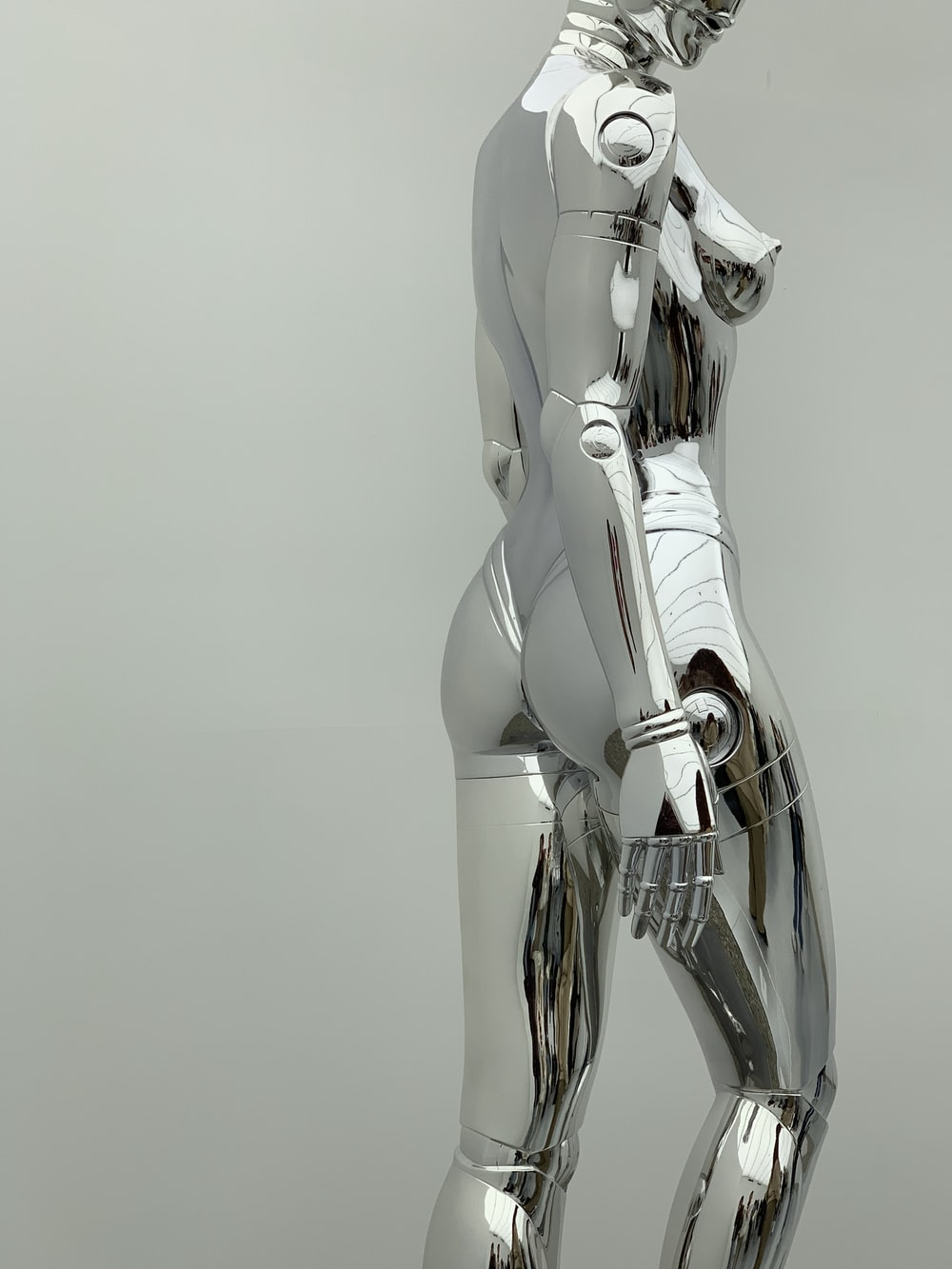 woman in silver suit with sword