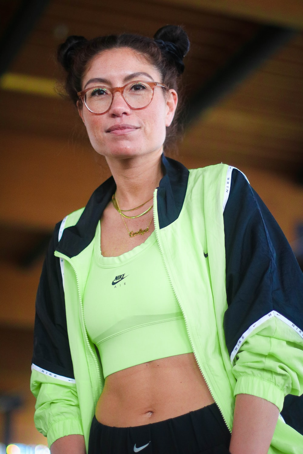 woman in yellow and blue adidas shirt wearing eyeglasses