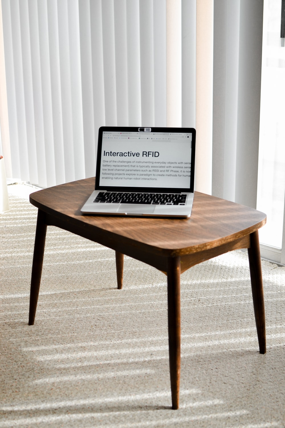 black laptop computer on brown wooden table