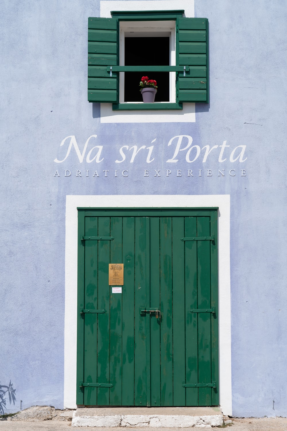 green wooden door with white and black happy new year text