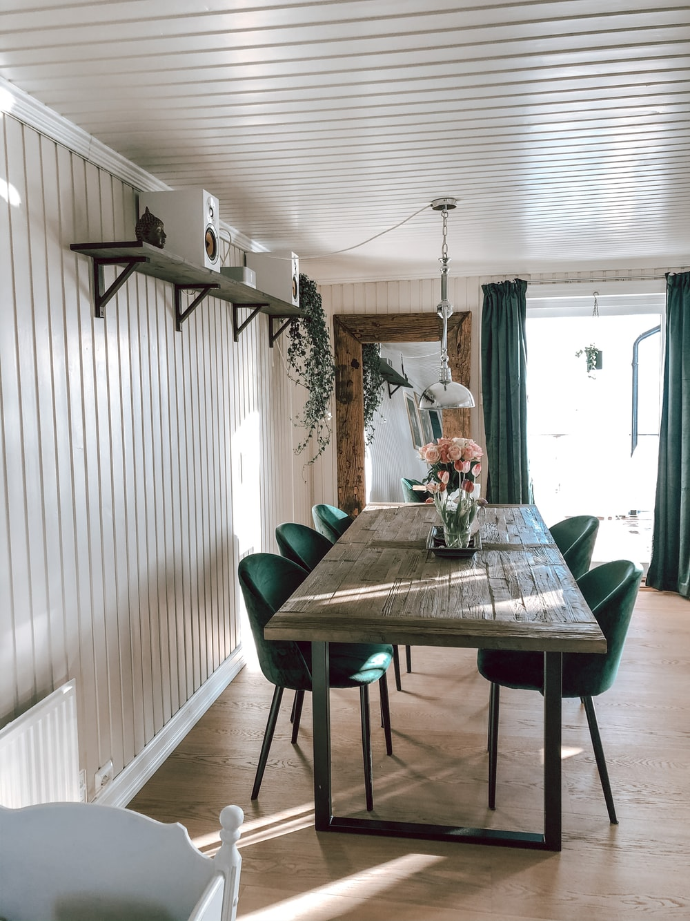 white and black dining table with chairs