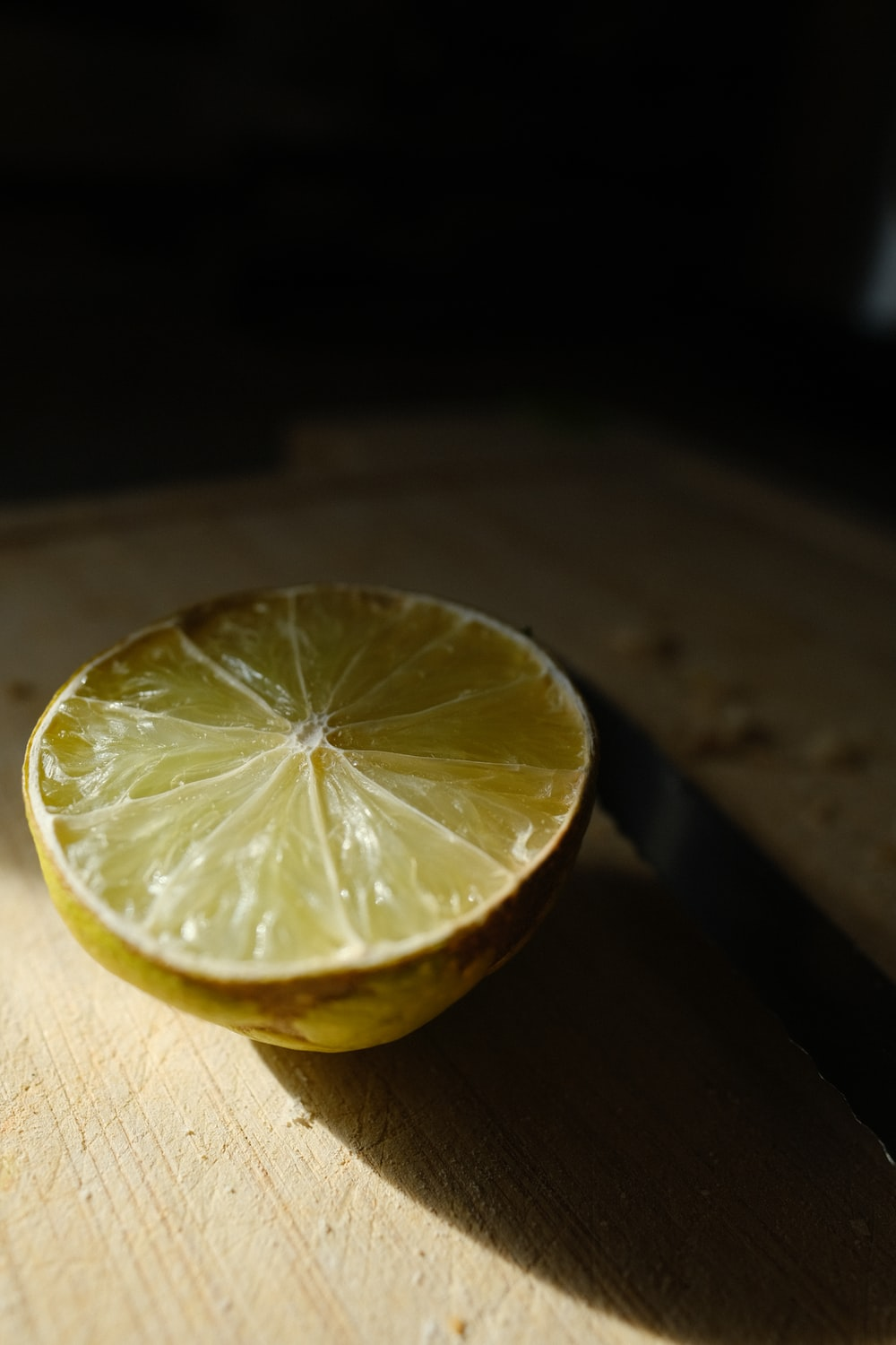 yellow lemon on brown wooden table