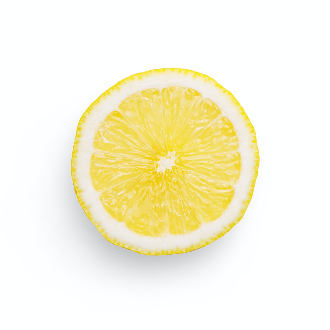 Quality photo of a slice of lemon on a white background