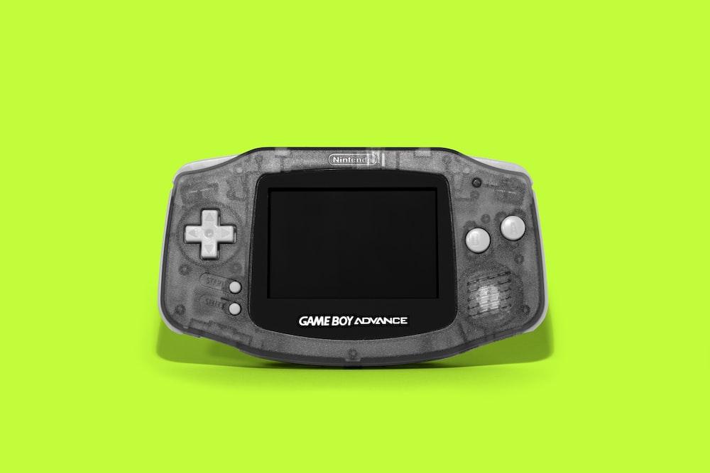 black sony digital device on green surface