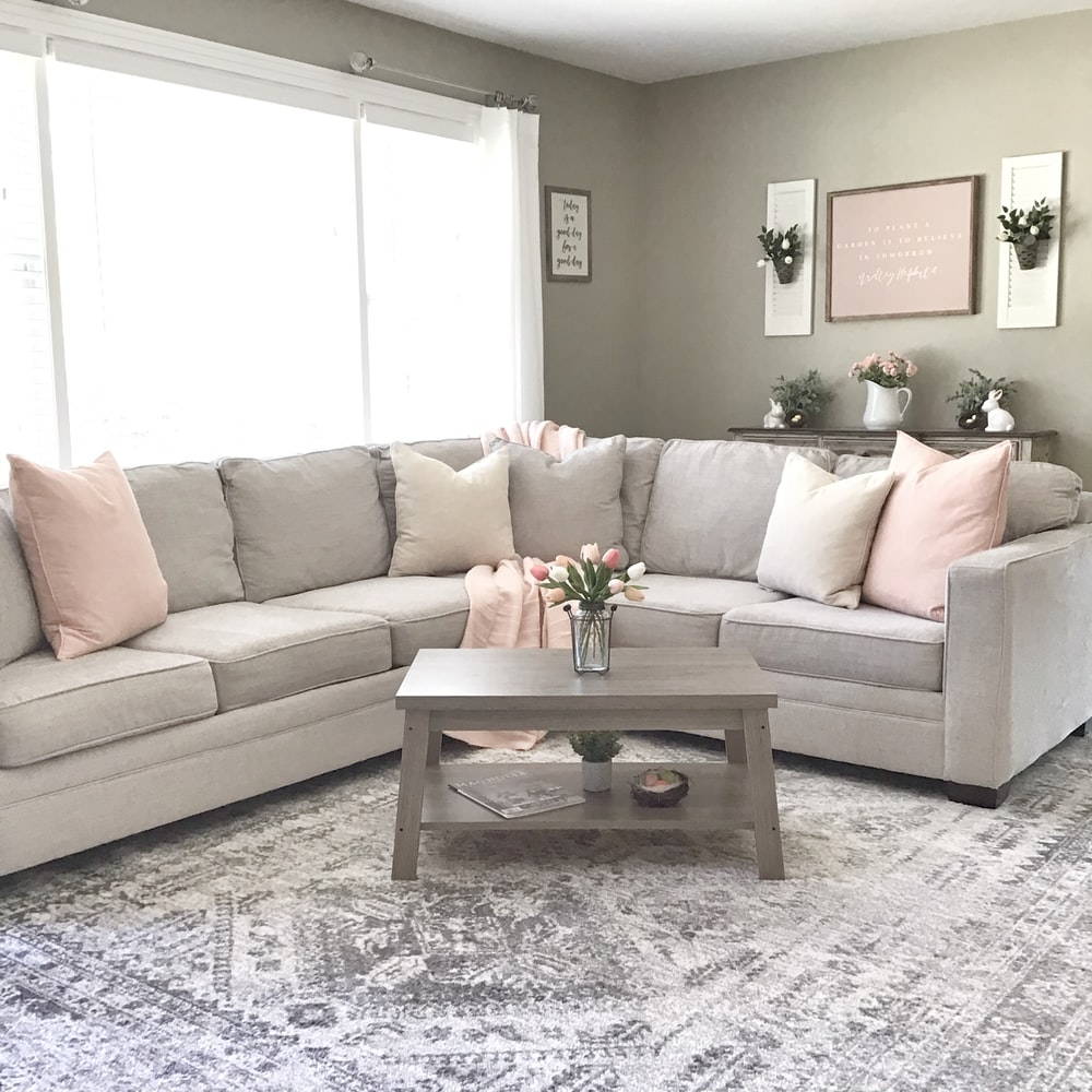 brown wooden coffee table near white couch