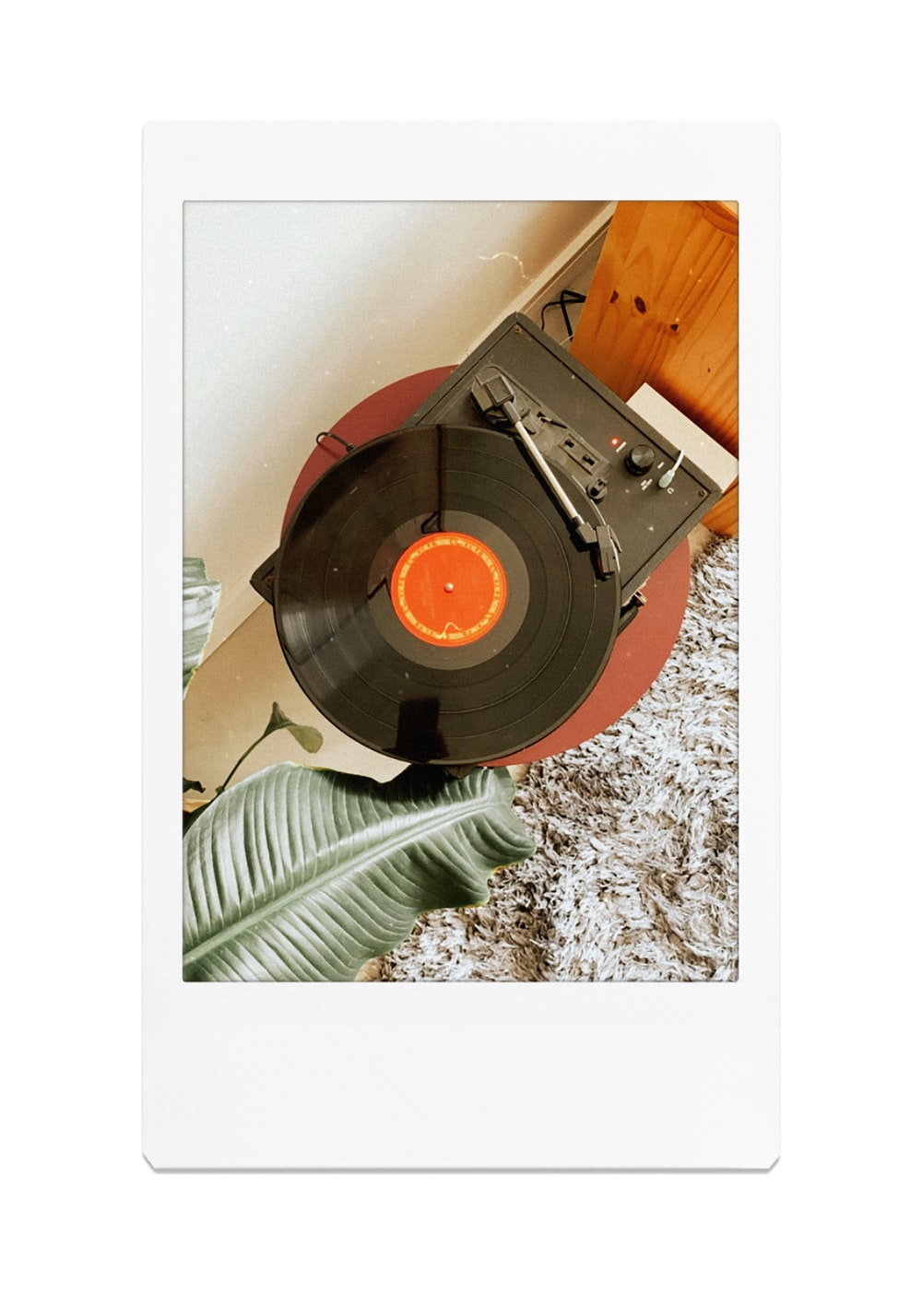 black vinyl record on white and black marble table