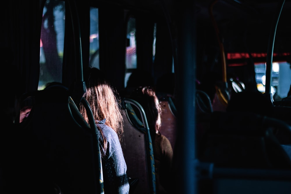 woman in blue denim jacket sitting inside car