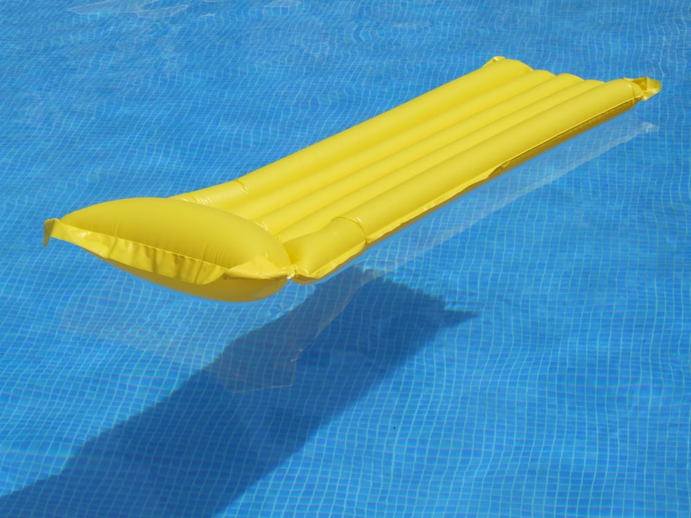 yellow inflatable ring on blue textile