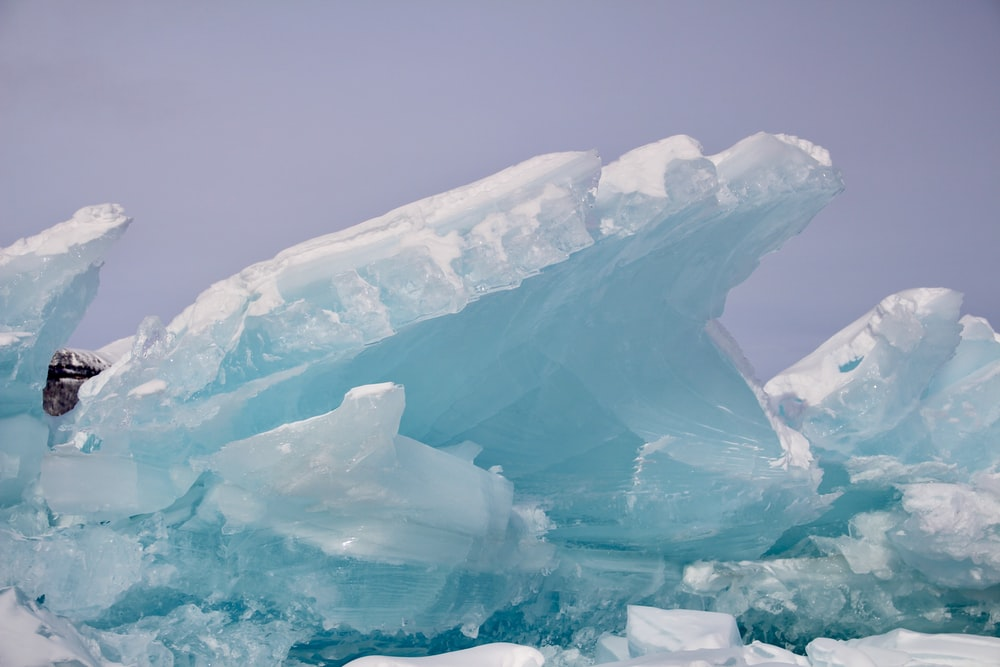 ice formation on body of water during daytime