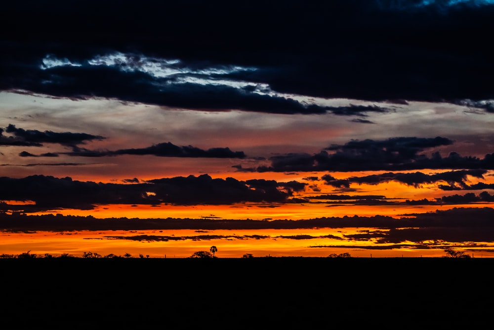 silhouette of clouds during sunset