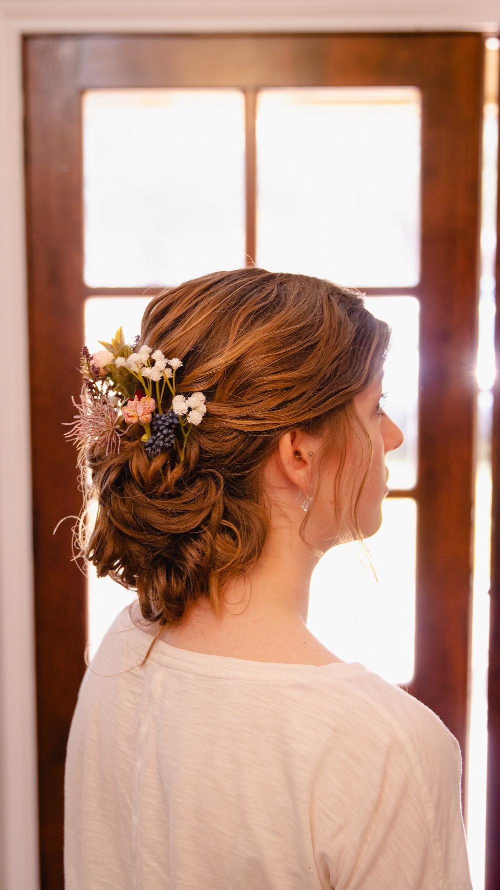 woman in white floral dress wearing white flower headband