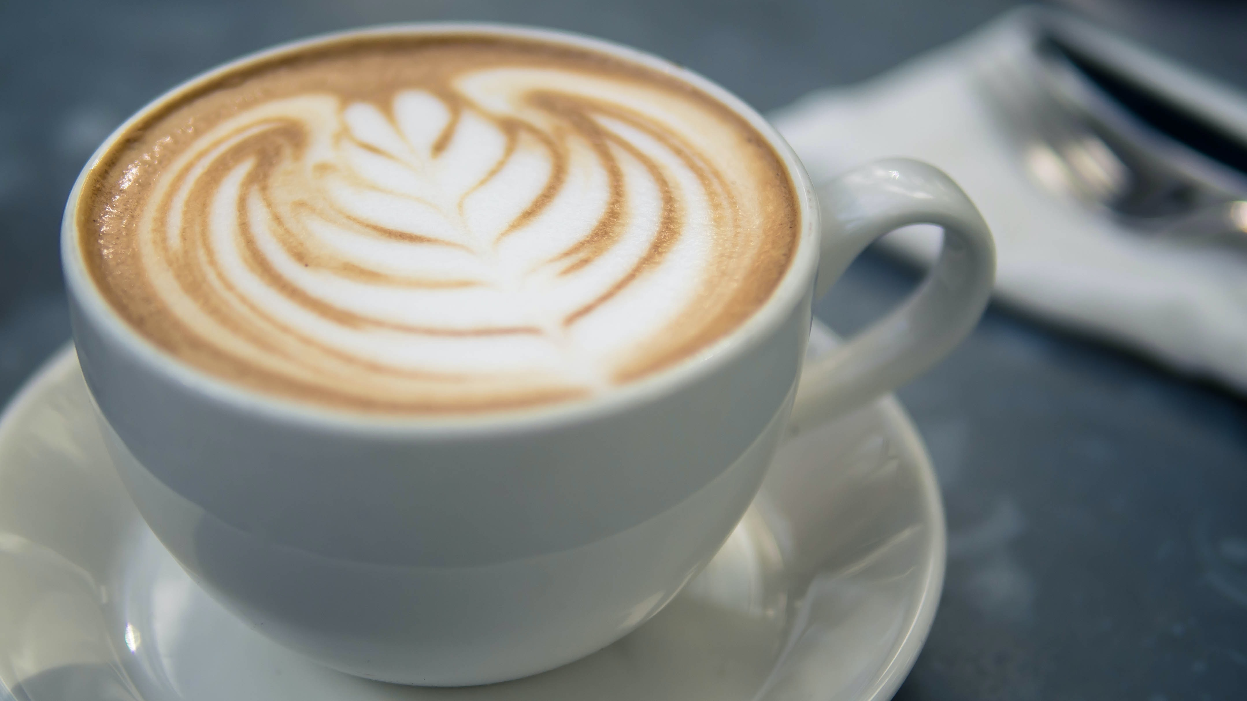 Close-up of a cup of cappuccino with latte art