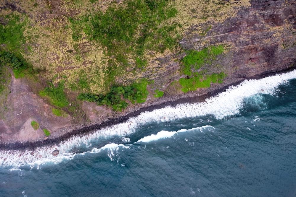 aerial view of seashore near land