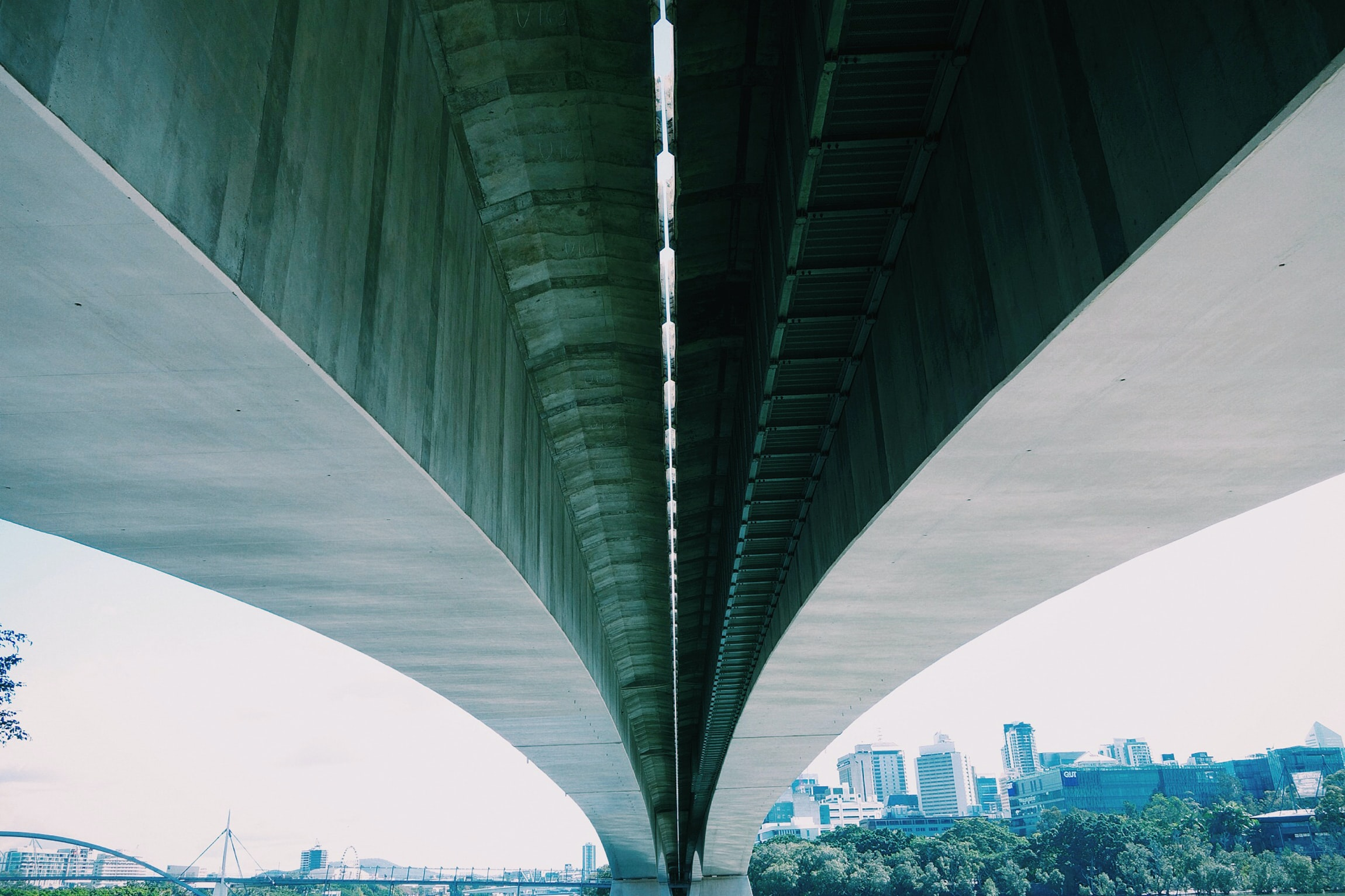 low angle photo of gray concrete bridge
