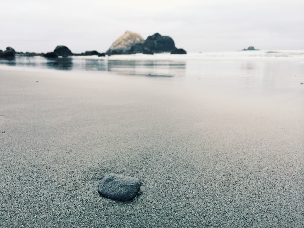 black stone on shoreline